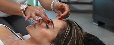 Woman having facial