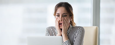 Shocked young women in front of computer