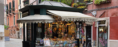 Kiosk with man selling magazines