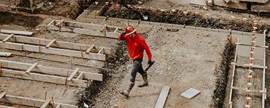 tradesman walking through construction site